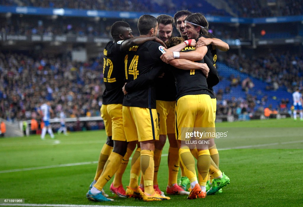 Atletico Madrid players celebrate a goal during the Spanish league football match RCD Espanyol vs Club Atletico de Madrid at the RCDE Stadium in Cornella de Llobregat on April 22, 2017. /