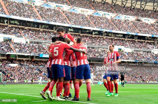 Atletico Madrid players celebrate a goal during the Spanish league football match between Real Madrid CF and Club Atletico de Madrid at the Santiago...