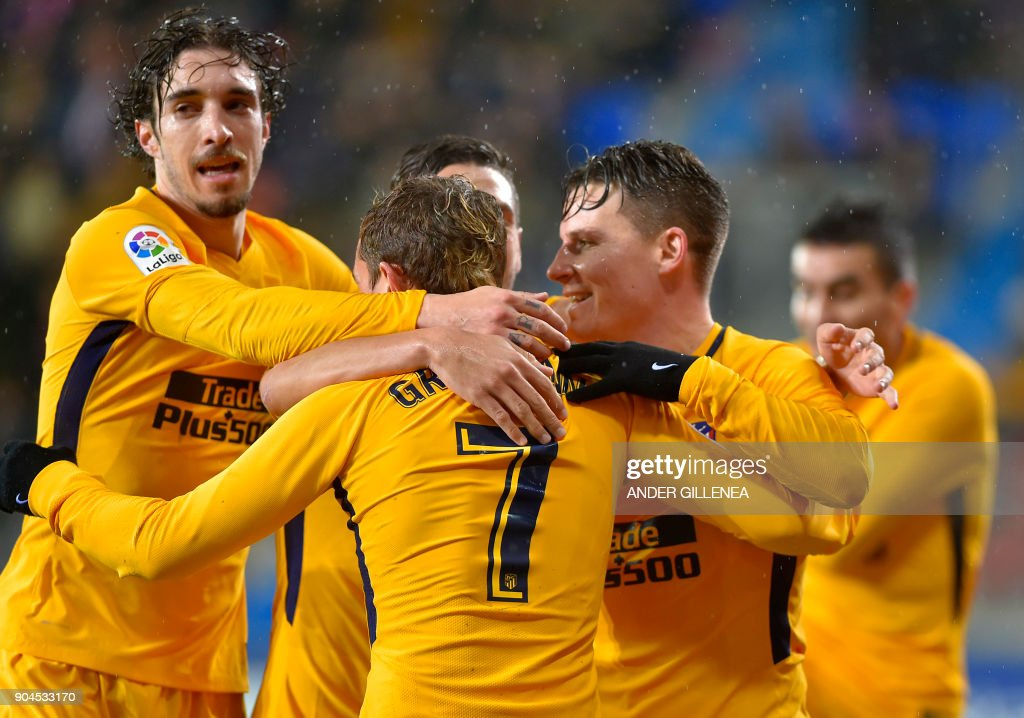 Atletico Madrid players celebrate after French forward Kevin Gameiro (R) scored his team's first goal during the Spanish league football match between SD Eibar and Club Atletico de Madrid at the Ipurua stadium in Eibar on January 13, 2018. /