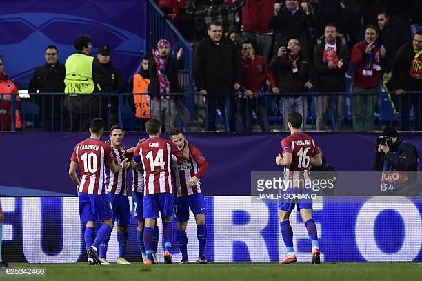 Atletico Madrid players celebrate after scoring a goal during the UEFA Champions League Group D football match Club Atletico de Madrid vs PSV...