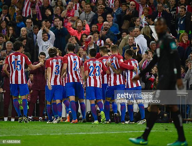 Atletico Madrid players celebrate after scoring during the Spanish league football match Club Atletico de Madrid vs Granada FC at the Vicente...