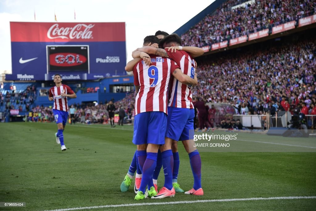 Atletico Madrid players celebrate after scoring during the Spanish league football match Club Atletico de Madrid vs SD Eibar at the Vicente Calderon stadium in Madrid on May 6, 2017. /
