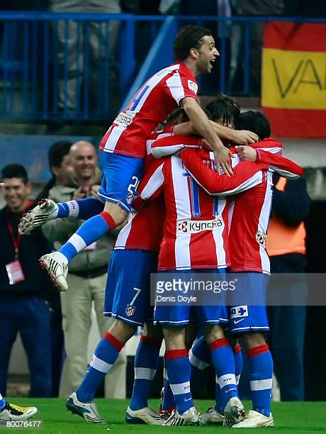 Atletico Madrid players celebrate after scoring their second goal during the La Liga match between Atletico Madrid and Barcelona at the Vicente...