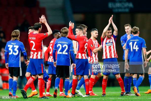 Atletico Madrid players celebrate at the end of the Europa League Round of 32 second leg football match between Club Atletico de Madrid and FC...