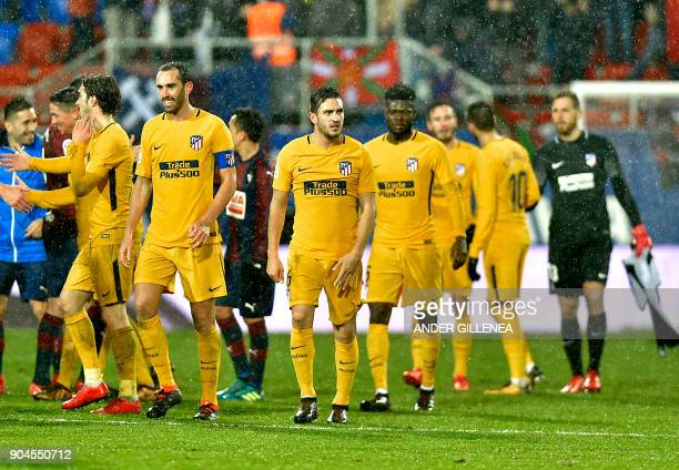 Atletico Madrid players celebrate at the end of the the Spanish league football match between SD Eibar and Club Atletico de Madrid at the Ipurua...