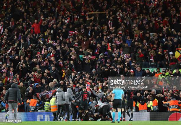 Atletico Madrid players celebrate in front of their travelling fans during the UEFA Champions League round of 16 second leg match between Liverpool...