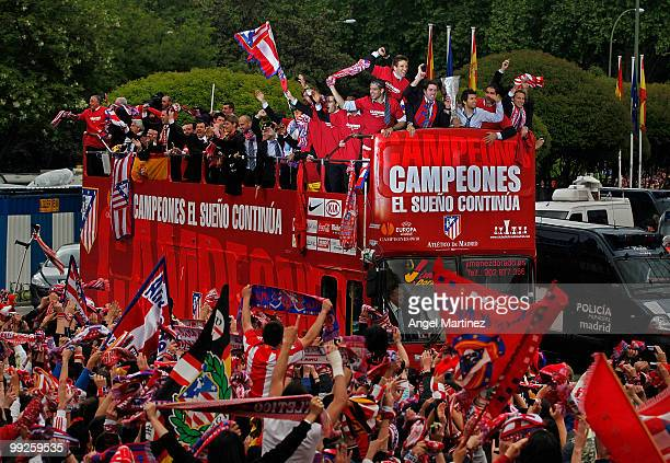 Atletico Madrid players celebrate on the top of an open bus at the Neptuno fountain in Madrid the day after Atletico won the UEFA Europa League Cup...