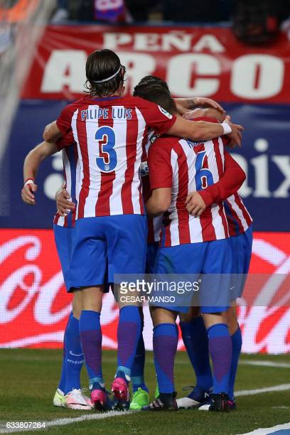 Atletico Madrid players celebrate their opening goal during the Spanish league football match Club Atletico de Madrid vs Club Deportivo Leganes SAD...