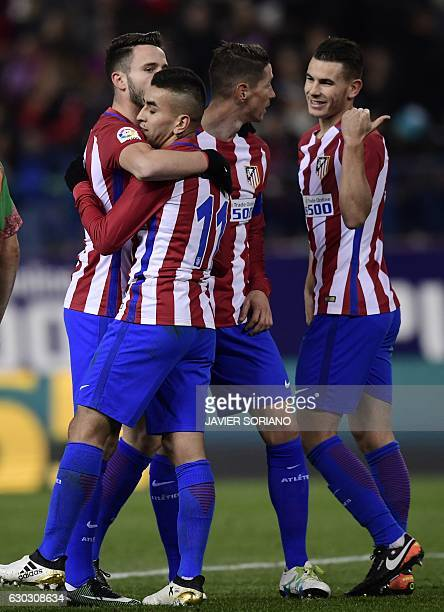 Atletico Madrid players celebrate their second goal during the Spanish Copa del Rey round of 32 second leg football match Club Atletico de Madrid vs...