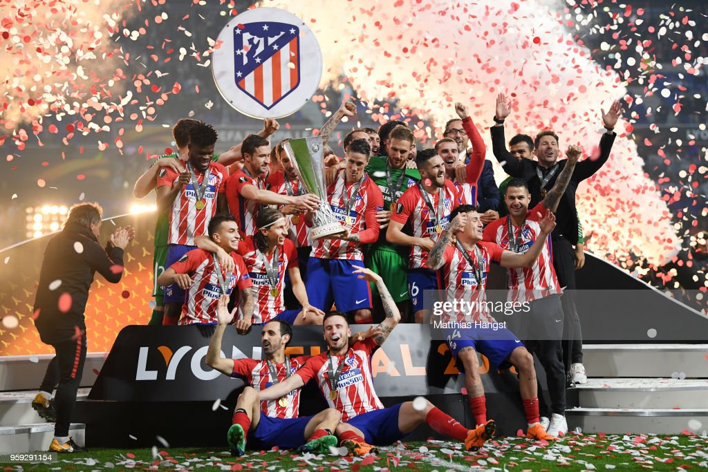 Atletico Madrid players celebrate with The Europa League trophy after winning the UEFA Europa League Final between Olympique de Marseille and Club Atletico de Madrid at Stade de Lyon on May 16, 2018 in Lyon, France.