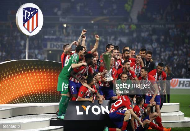 Atletico Madrid players celebrate with The Europa League trophy after the UEFA Europa League Final between Olympique de Marseille and Club Atletico...