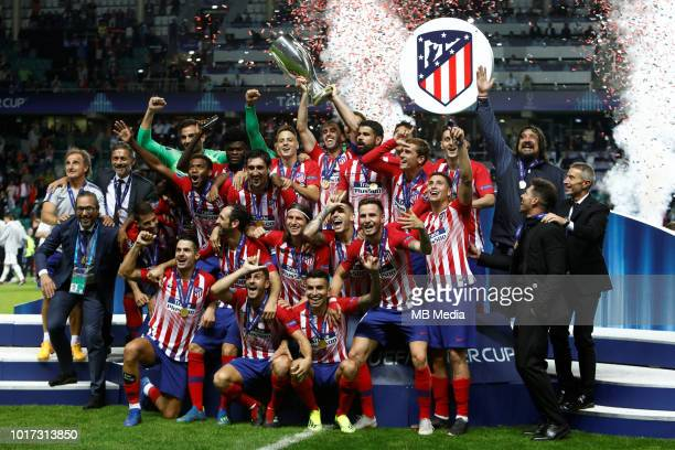 Atletico Madrid players celebrate with the trophy after the UEFA Super Cup match between Real Madrid and Atletico Madrid at Lillekula Stadium on...