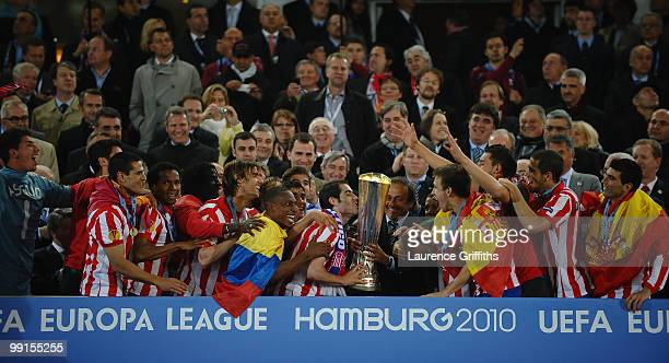 Atletico Madrid players celebrate with the UEFA Europa League trophy after extra time following their victory at the end of the UEFA Europa League...
