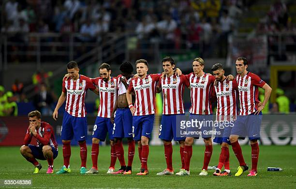 Atletico Madrid players look on during the penalty shoot out during the UEFA Champions League Final match between Real Madrid and Club Atletico de...