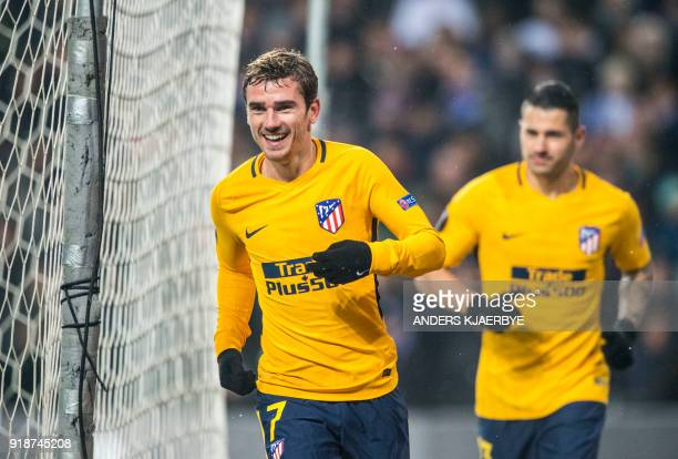 Atletico Madrid striker Antoine Griezmann celebrates after scoring during the UEFA Europa League Round of 32 first leg football match between FC...