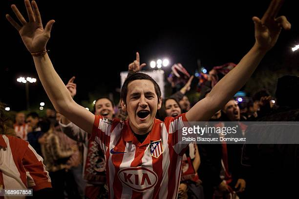 Atletico Madrid supporters react after winning the Copa del Rey Final game between Real Madrid and Atletico de Madrid at Neptuno Square on May 17...