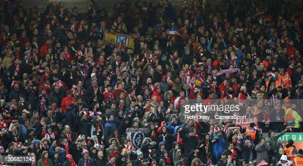 Atletico Madrid travelling fans watch the first half action during the UEFA Champions League round of 16 second leg match between Liverpool FC and...