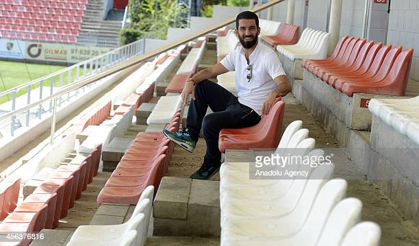 Atletico Madrid's Arda Turan poses during an exclusive interview following a training session ahead of the UEFA Champions Leaguge Group A game...