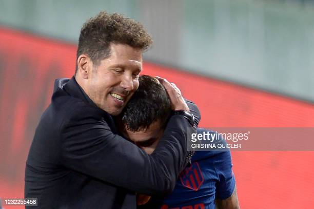 Atletico Madrid's Argentine coach Diego Simeone hugs Atletico Madrid's Argentine forward Angel Correa at the end of the Spanish League football match...