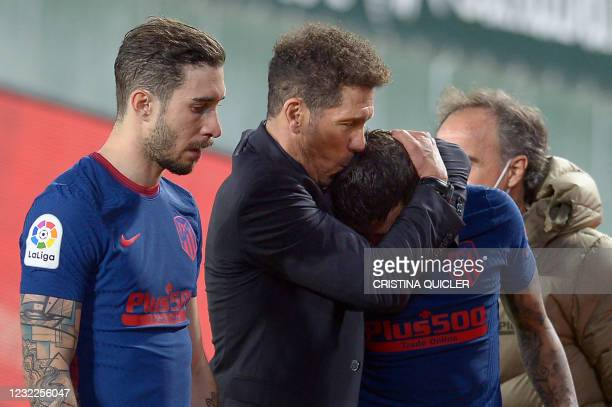 Atletico Madrid's Argentine coach Diego Simeone kisses Atletico Madrid's Argentine forward Angel Correa at the end of the Spanish League football...