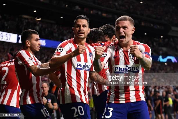 TOPSHOT Atletico Madrid's Argentine forward Angel Correa Atletico Madrid's Spanish midfielder Vitolo and Atletico Madrid's English defender Kieran...