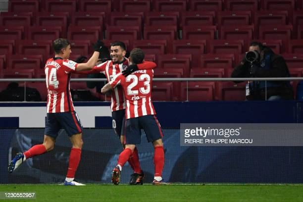 Atletico Madrid's Argentine forward Angel Correa celebrates his goal with teammates Atletico Madrid's Spanish midfielder Marcos Llorente and Atletico...