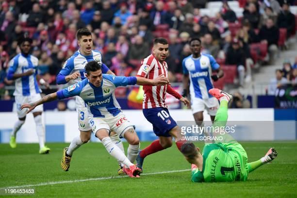 Atletico Madrid's Argentine forward Angel Correa challenges Leganes' Spanish goalkeeper Ivan Cuellarduring the Spanish league football match Club...