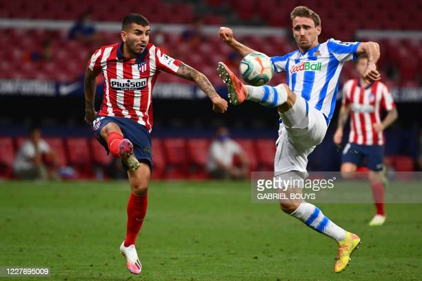 Atletico Madrid's Argentine forward Angel Correa vies with Real Sociedad's Spanish defender Nacho Monreal during the Spanish league football match...