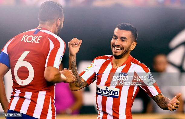 Atletico Madrid's Argentine foward Angel Correa celebrates after scoring with teammate Spanish midfielder Koke during their 2019 International...