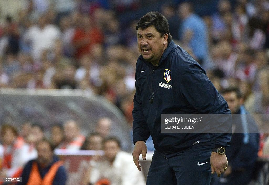 Atletico Madrid's Argentinian assistant coach German Burgos reacts during the Spanish league football match Club Atletico de Madrid vs Celta de Vigo at the Vicente Calderon stadium in Madrid on September 20, 2014. The game ended in a draw 2-2.