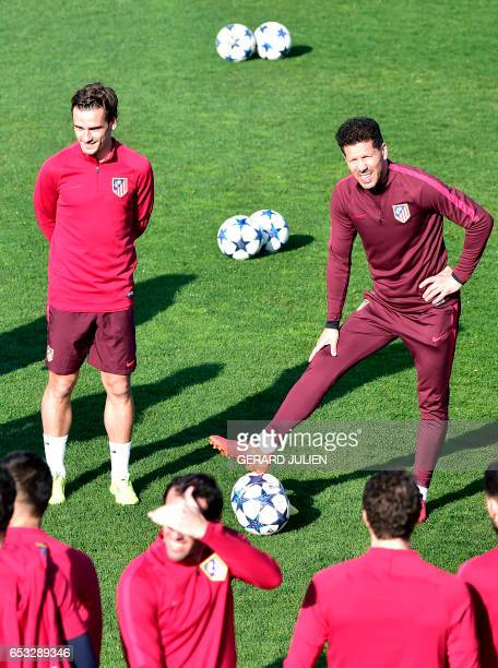 Atletico Madrid's Argentinian coach Diego Simeone and Atletico Madrid's French forward Antoine Griezmann stand in front of Atletico Madrid's players...