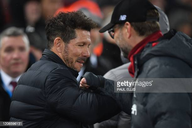 Atletico Madrid's Argentinian coach Diego Simeone and Liverpool's German manager Jurgen Klopp gesture during the UEFA Champions league Round of 16...