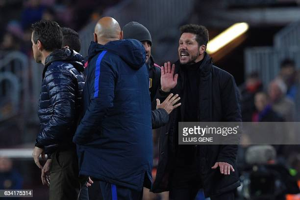 Atletico Madrid's Argentinian coach Diego Simeone argues with the third referee during the Spanish Copa del Rey semi final second leg football match...