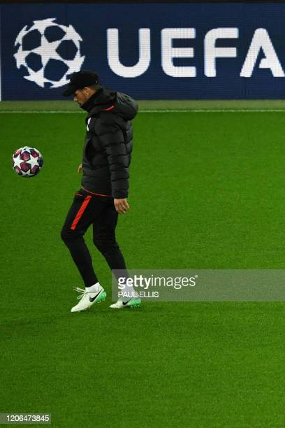 Atletico Madrid's Argentinian coach Diego Simeone attends a training session at Anfield stadium in Liverpool north west England on March 10 on the...
