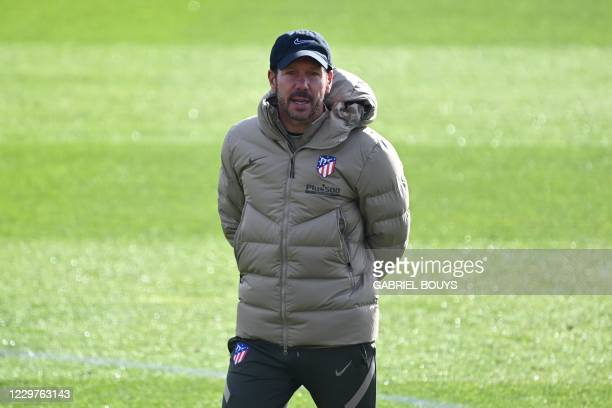 Atletico Madrid's Argentinian coach Diego Simeone attends a training session at the club's training ground in Majadahonda near Madrid on November 24,...
