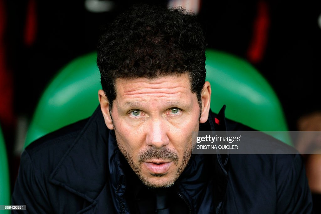 Atletico Madrid's Argentinian coach Diego Simeone attends the Spanish league football match between Real Betis and Atletico Madrid at the Benito Villamarin Stadium in Sevilla on December 10, 2017. /