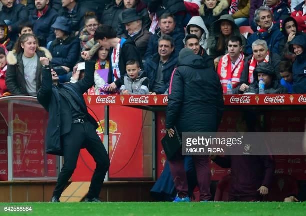 Atletico Madrid's Argentinian coach Diego Simeone celebrates a goal during the Spanish league football match Real Sporting de Gijon vs Club Atletico...