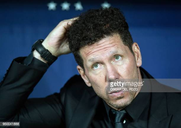 Atletico Madrid's Argentinian coach Diego Simeone gestures before the Spanish league football match between Club Atletico de Madrid and Real Betis at...
