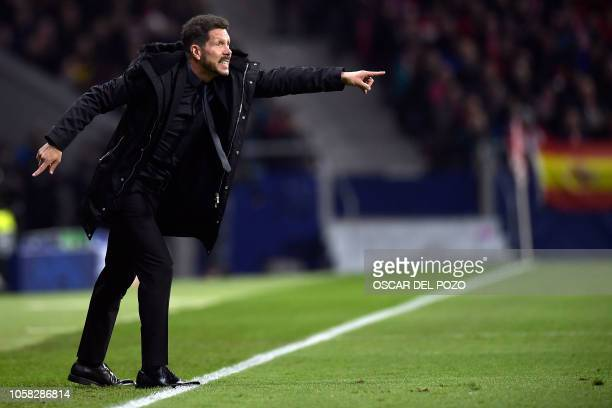Atletico Madrid's Argentinian coach Diego Simeone gestures during the UEFA Champions League group A football match between Club Atletico de Madrid...