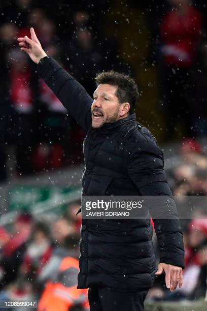 Atletico Madrid's Argentinian coach Diego Simeone gestures during the UEFA Champions league Round of 16 second leg football match between Liverpool...