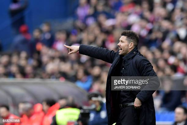 Atletico Madrid's Argentinian coach Diego Simeone gestures during the Spanish league football match Club Atletico de Madrid vs Valencia CF at the...