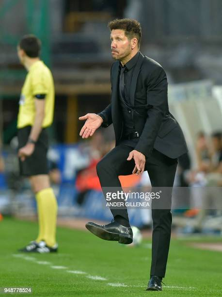 Atletico Madrid's Argentinian coach Diego Simeone gestures during the Spanish league football between Real Sociedad and Club Atletico de Madrid at...