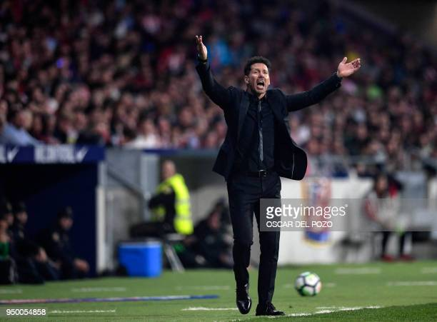 Atletico Madrid's Argentinian coach Diego Simeone gestures during the Spanish league football match between Club Atletico de Madrid and Betis at the...