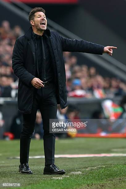 Atletico Madrid's Argentinian coach Diego Simeone gestures on the sideline during the Spanish league football match Athletic Club Bilbao vs Club...