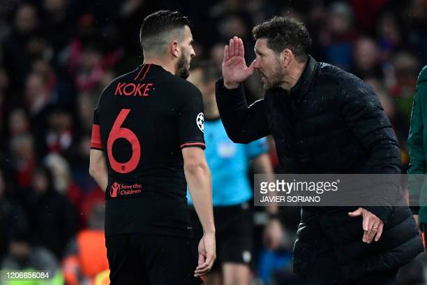 Atletico Madrid's Argentinian coach Diego Simeone gestures to Atletico Madrid's Spanish midfielder Koke during the UEFA Champions league Round of 16...