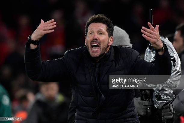 Atletico Madrid's Argentinian coach Diego Simeone reacts after Atletico Madrid's Spanish striker Alvaro Morata scores his team's third goal during...