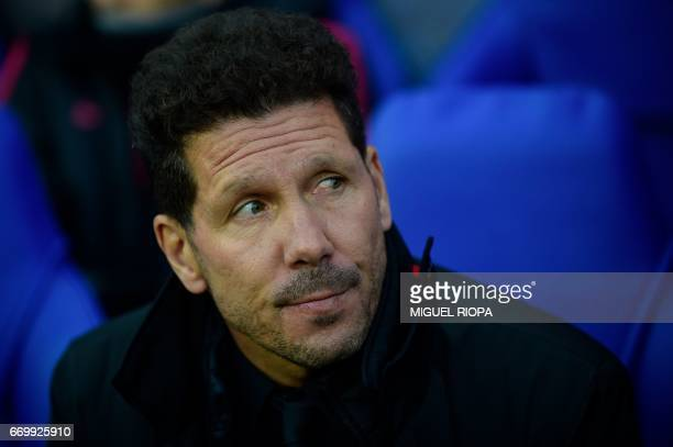 Atletico Madrid's Argentinian coach Diego Simeone reacts ahead of the UEFA Champions League quarterfinal second leg football match between Leicester...