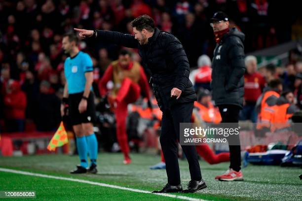 Atletico Madrid's Argentinian coach Diego Simeone reacts as Liverpool's German manager Jurgen Klopp looks on during the UEFA Champions league Round...