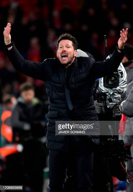 Atletico Madrid's Argentinian coach Diego Simeone reacts at the final whistle during the UEFA Champions league Round of 16 second leg football match...
