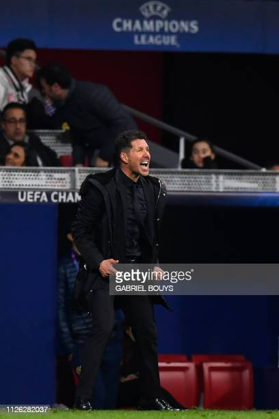 Atletico Madrid's Argentinian coach Diego Simeone reacts during the UEFA Champions League round of 16 first leg football match between Club Atletico...